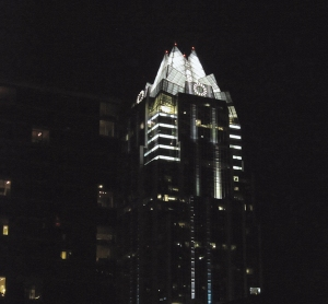 A building downtown, lit up all gothicky and sweet at night