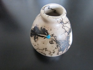 Navajo horsehair pottery, hand-made, hand-painted and adorned with turquoise.