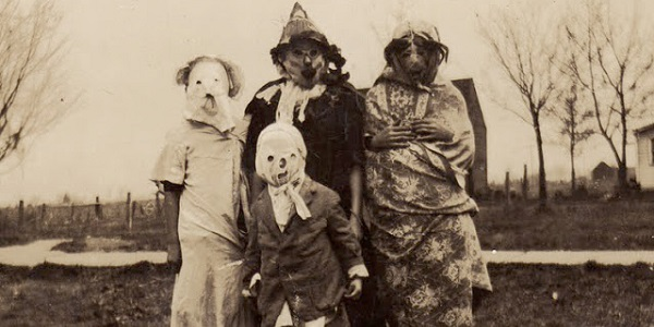 Old-fashioned Halloween masks, typical of their time. No teeth.
