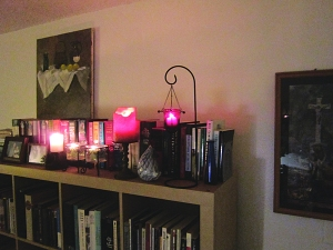 The typical array of candles, framed photos and knick-knacks lining the top shelf, and some art made by friends.