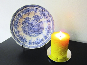 """Blue and white toile  Luneville """"The Cottage"""" plate from Callaghan's family in France. The candle is the """"Melt"""" Lemon Verbena and Sage pillar candle (Nest Fragrances)"""