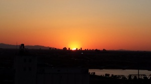 Silhouette of the Phoenix skyline against the deepening sunset