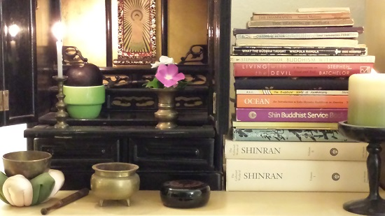 My Butsudan (altar/shrine) with my 20+ books and pamphlets (some not shown) on the subject of Buddhism, ranging from ancient spiritual texts to college-level textbooks.