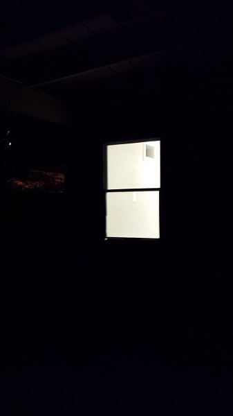 The laundry room in the dark.
