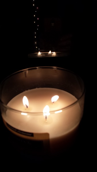 Reflecting lights... candle flames on a dark morning.