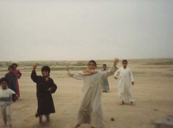 As we moved through Kuwait, children came running out from nowhere to greet us, happy and excited