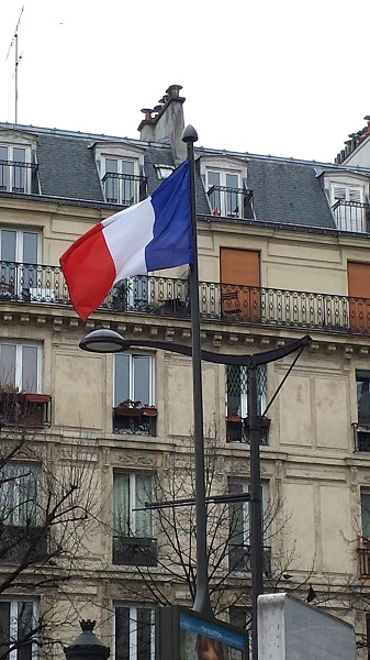 French flag at the Metro station on Boulevard Barbès.
