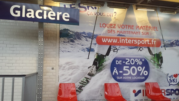"Glacière is a stop on the Metro. We thought it was funny to see the sign next to a ski ad (""Glacière"" translates to ""ice chest."")"