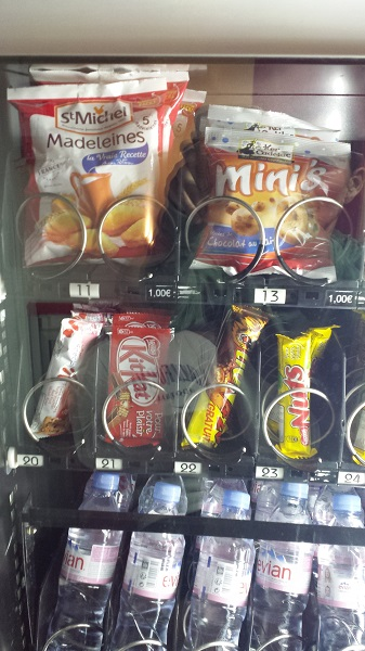 The vending machine at FitLane is all Evian water, except for two rows of snacks at the top. Something you'd never find in an American vending machine: Madeleines. There's no junk food in our gym in Arizona, at all... just energy drinks, protein shakes and water.