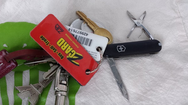 My keys, complete with my Victorionox Swiss Army knife (which includes pointed-tip scissors).