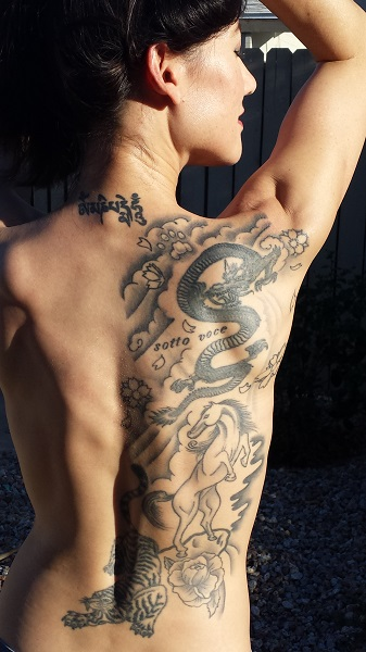 """Here's a clearer view. The Sanskrit script at the base of my neck reads, """"om mani padme hum,"""" my favorite Buddhist mantra."""