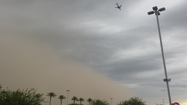 A wall of dust rolling in ahead of a thunderous rain.