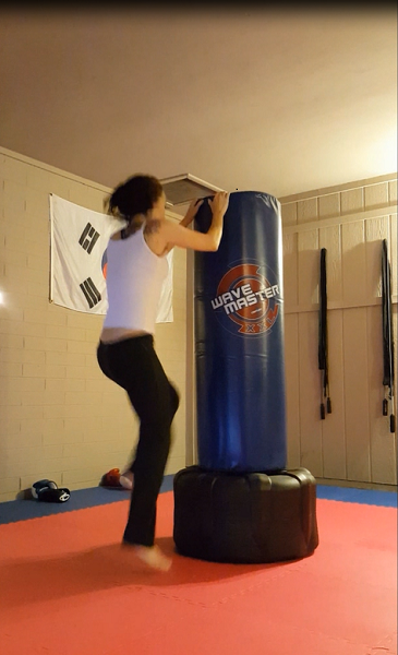 100 alternating foot hop-ups (or whatever you call them) on the standing bag.