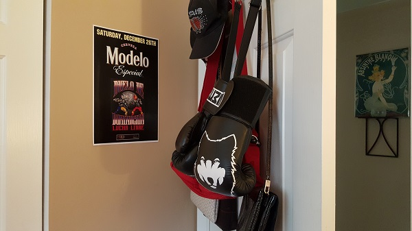 Behind the door (Lucha Libre poster, boxing gloves, bags, hats)