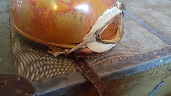 Antique helmet on antique German trunk