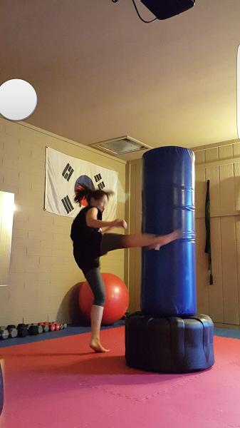 Muay Thai round kick.