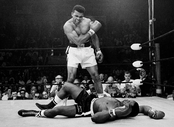 Cassius Clay (Ali) knocks out Sonny Liston