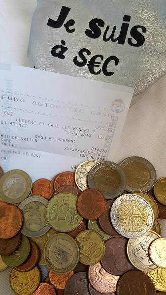 The euros I still had when we moved back here, an ATM receipt, and my coin purse.