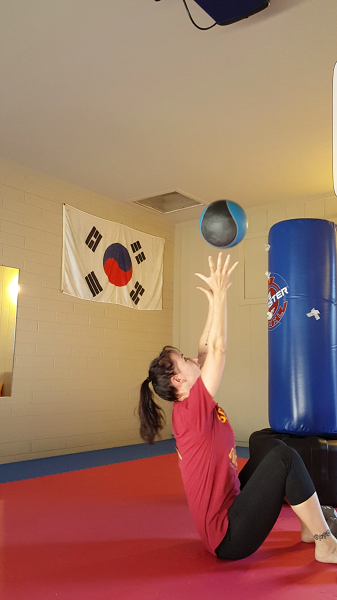 Medicine ball crunch (top)