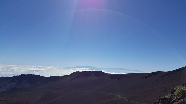 Blue sky, carpet of clouds